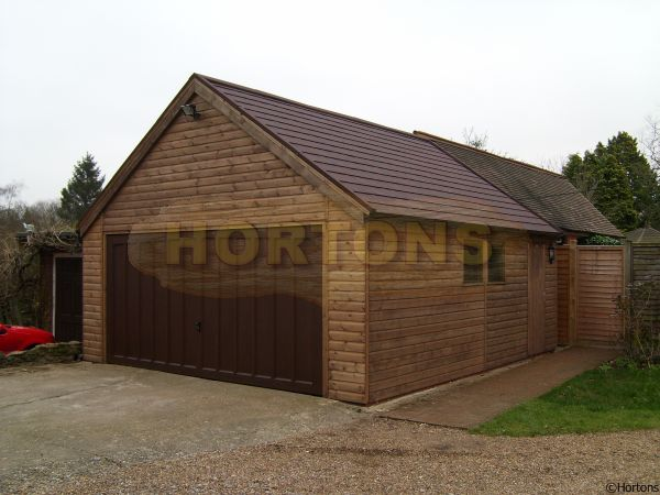 Log cabins timber framed garages for Log cabin garage